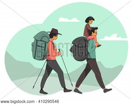 A Young Family Goes On A Hike. Mom And Dad With A Child Go With Backpacks Against The Backdrop Of Mo