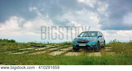 Lypovets, Ukraine - Jun 22, 2019: Suv On The Concrete Roadside On Top Of The Mountain Runa. Travel C