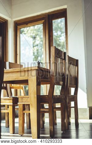 Shot Of A Dining Table With Focus On The Dining Chairs Captured In Interior Of A Restaurant.