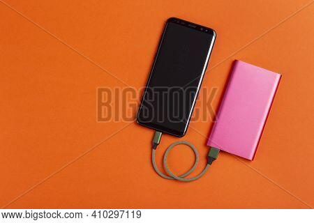 Smartphone Charging With Power Bank. Portable Power Bank For Charging Mobile Devices. Battery Bank.