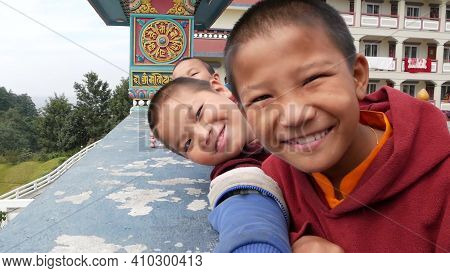 Bhaktapur, Kathmandu, Nepal - 18 October 2018 Laughing Ethnic Boys Of Monastery Smiling At Camera. A