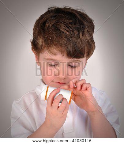 Child Looking At Pill Bottle Prescription