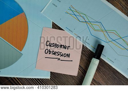 Customer Obsession Write On Sticky Notes Isolated On Wooden Table.