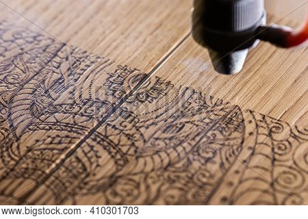 Saint Petersburg, Russia / February 24, 2021:laser Engraves The Image Of An Indian Elephant On A Woo