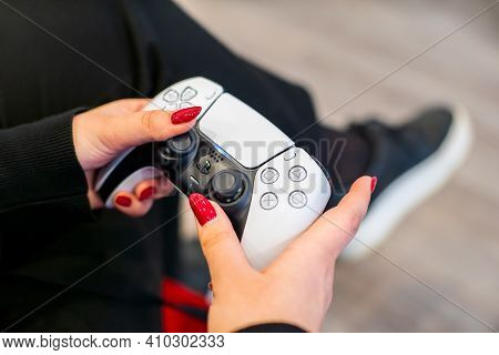 Girl Plays On The Game Console On Ps5. Controller In Hands Close-up.