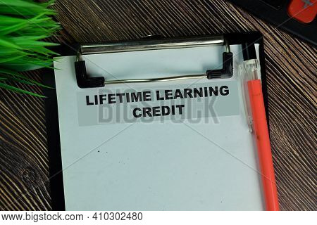 Lifetime Learning Credit Write On A Paperwork Isolated On Wooden Table.