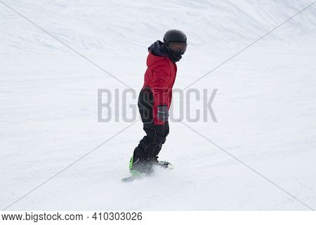 A Snowboarder On A Snowboard. Extreme Winter Sports.rest In Winter.