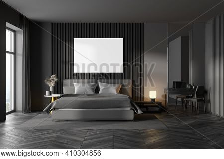 Dark Bedroom Interior With Wooden Parquet, A Large Window, A Gray Bed And Two Bedside Tables. A Cabi