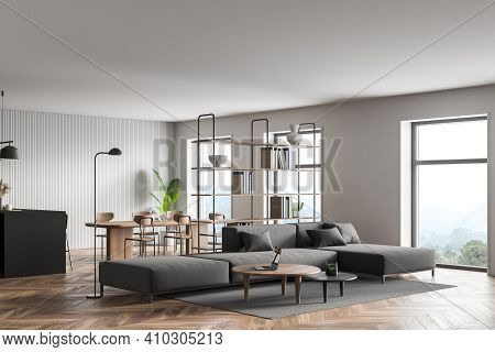 Stylish White And Green Living Room Interior With Wooden Floor, Long Grey Sofa, Two Round Coffee Tab