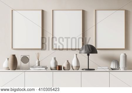 Three Mock Up Posters Frame On Wall In Modern Interior Background, Living Room. Books Vase Lamp On C