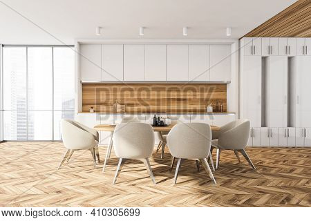 Wooden Dining Room, City View On Skyscrapers. Dining Table With Dishes And Six Armchairs. Kitchen Se