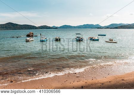 Travel Shot Of Caribbean Setting Of Peng Chau Island Sandy Beach With Turquoise Blue Water And Fishi
