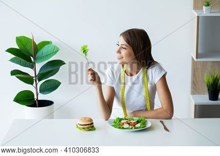 Young Woman On A Diet, Eats Only Salad And Tries To Lose Weight