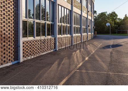 School Building And Schoolyard In The Evening