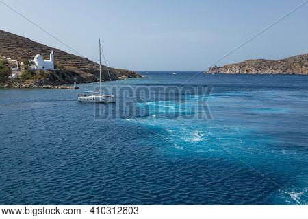 Chora, Ios Island, Greece- 26 September 2020: Boat Departing From The Port Of Chora. Agia Irini, Sai