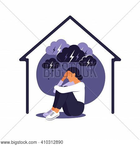 Domestic Violence Against Women Concept. Woman Sits Alone At Home Under Rainy Stormy Cloud. Her Embr