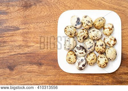 Fresh Small Spotted Partridge Eggs On White Board
