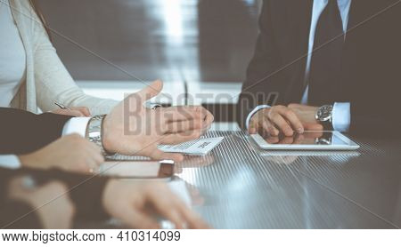 Business People Working Together At Meeting In Modern Office. Unknown Businessman And Woman With Col