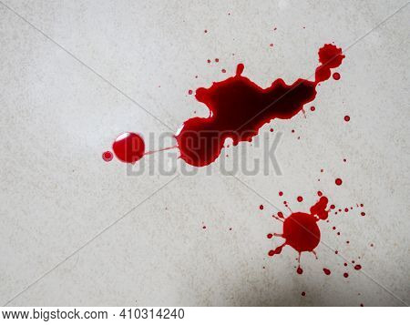 Blood Drops Splatter On White Floor. Red Dripping Blood Drop. Healthy And Halloween Concept.