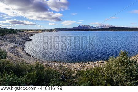 Lake With Clouds, Blue Sky And Reflections In The Water. Atazar Reservoir Madrid