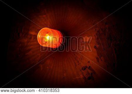 Emergency Lighting In The Factory, Warning Light, Orange Siren On Concrete Wall.