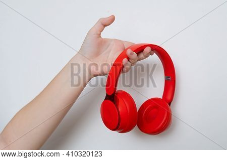 Hand Holding Bluetooth Red Headphones Device Women
