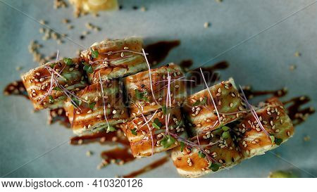 Top View Of Tasty Fresh Sushi Roll Set With Unagi And Sesame Decorated And Served On A Plate. Sushi