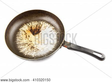 Old Stained Aluminium Pan With Burnt Fat And Peeled Off Tfe Non-stick Coating And Burnt Fat Isolated