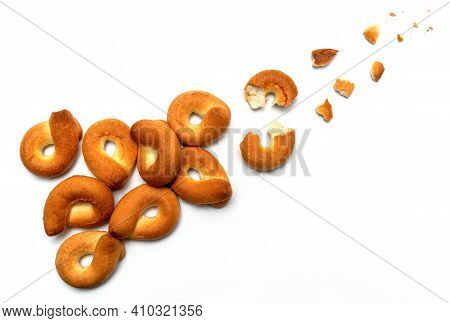 Homemade Bagel Isolated On White Background. Trajectory Or Flight Of Broken Parts And Crumbs Top Vie
