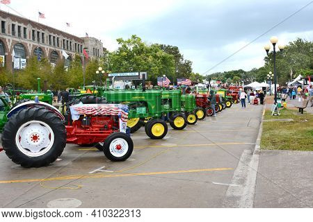 DES MOINES, IOWA - AUGUST 19, 2015: A display of farm tractors at the Iowa State Fair. The fair covering over 450 acres is one of the largest state fairs in the country.