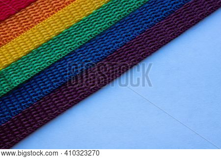 Lgbt Rainbow Ribbon On A White Background.rainbow Background. Space For Your Text.