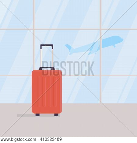 Travel Suitcase In Empty Waiting Area Of Airport Terminal, Against Background Of Large Windows, Take