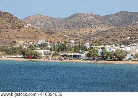 Chora, Ios Island, Greece- 26 September 2020: View Of Sandy Beach On The Greek Island Of Ios Sunbeds