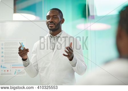Waist Up Portrait Of African-american Man Standing By Whiteboard While Giving Presentation During Me