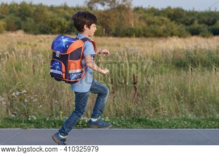 Returning To School Concept, Portrait Of Happy Boy With Backpack, School Child Waiting For School Bu