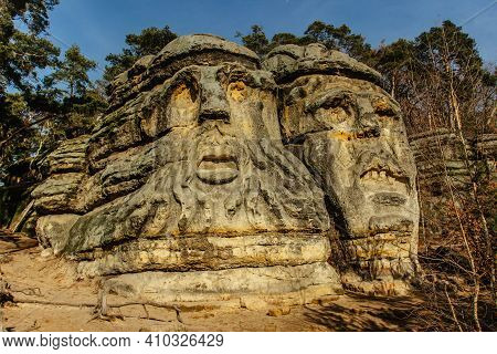 Two Giant Heads Of Devils Carved Into Sandstone Rocks,each Is About 9m High.devils Heads Created By