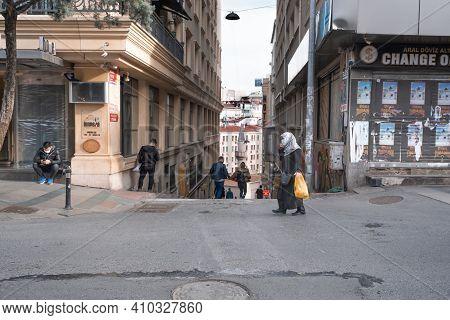 Beyoglu, Istanbul, Turkey - 02.17.2021: People With Covid Protection Masks Walking In Taksim Sirasel