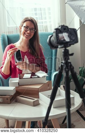 Woman Blogger Makes Video Of Unpacking Gadgets At Home