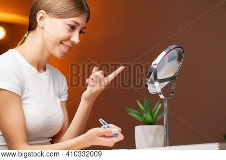 Smiling Woman With Contact Eye Lenses And Container In Hand.
