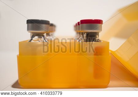 Box Of Vaccine Ampules Or Glass Vials. Selective Focus. Isolated Over White