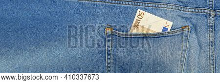 Money In My Jeans Pocket, 50 Euros In The Back Pocket Of Blue Jeans. Wealth And Prosperity Concept.