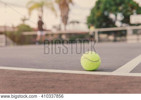 Green Tennis Ball On Court Line. Tennis Game, Active Sport, Family Recreation And Wellbeing Concept