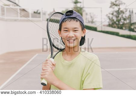 Asian Preteen Tween Boy Playing Tennis,  Healthy Young Athletes Training, Active Wellbeing Concept