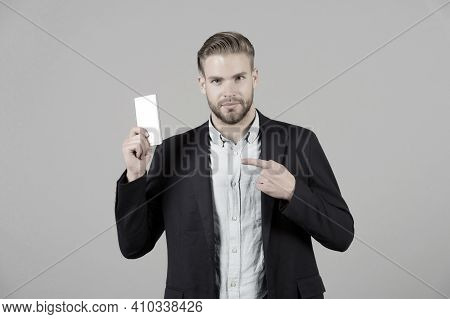 Man Point Finger At Mobile Phone. Businessman With Beard In Formal Suit Show Smartphone. Presentatio