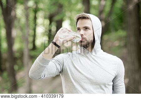 Staying Hydrated. Athlete Drink Water After Training In Park. Care Body Hydration. Sport And Health.