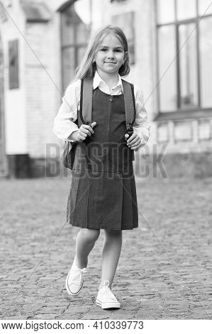 Happy Small Child In Formal Uniform Carry School Bag Outdoors, September 1.