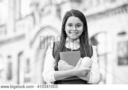 Diet Cures More Than Doctors. Happy Schoolgirl Hold Apple And Book. School Break. Fruit Snack. Veget