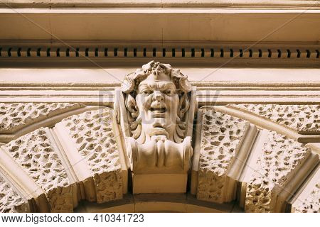 A Bas-relief On The Facade In The Form Of A Human Face.