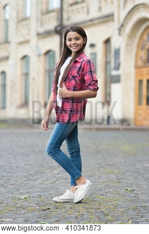 We Will Make You Best. Fashion Look Of Little Child. Happy Girl Give Thumbs Up Outdoors. Wearing Cas