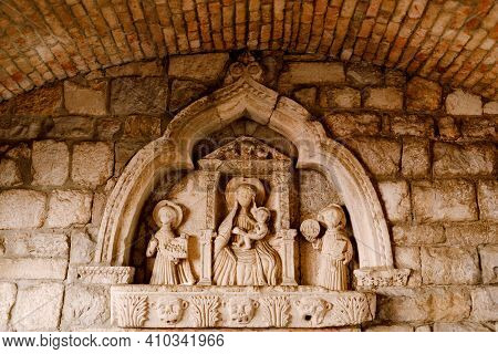 Bas-relief In The Niche Of The Kotor Sea Gate Depicting The Madonna And Child.